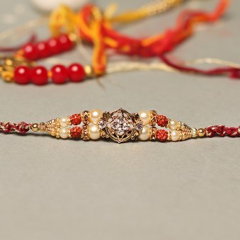 Floral Ruby Red Dial Metal Rakhi Online