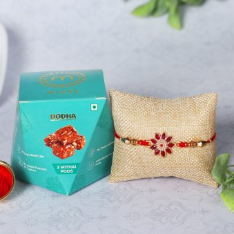 Floral Rakhi With Dodha Barfi Sweets Online